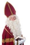 Sinterklaas e seu livro Fotos de Stock Royalty Free