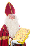 Sinterklaas is giving a present Royalty Free Stock Photography