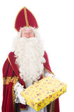 Sinterklaas is giving a present Royalty Free Stock Photo