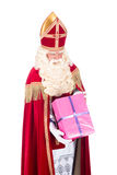 Sinterklaas is giving a present Stock Images