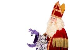 Sinterklaas holding car key on white background Royalty Free Stock Photo