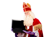 Sinterklaas with laptop Stock Images