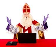 Sinterklaas with laptop Stock Photography