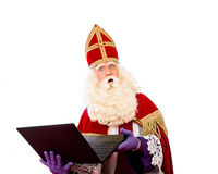 Sinterklaas with laptop Stock Photography