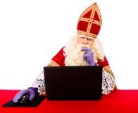 Sinterklaas with laptop Royalty Free Stock Image