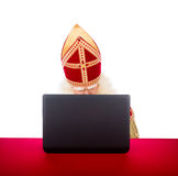 Sinterklaas with laptop Royalty Free Stock Photos