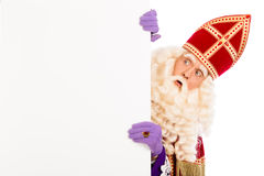 Sinterklaas looking on advertisement. Isolated on white background. Dutch character of Santa Claus Royalty Free Stock Images