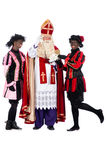 Sinterklaas is making a phonecall. Zwarte Piet (Black Pete) is a character, part of a  Dutch tradition called Sinterklaas, which is celebrated at December the Stock Photography