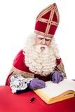 Sinterklaas med boken Royaltyfria Bilder