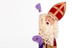 Sinterklaas met aanplakbiljet Stock Foto's