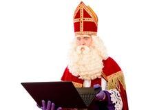 Sinterklaas met laptop Royalty-vrije Stock Foto's