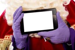 Sinterklaas mit Tablette Lizenzfreies Stockbild