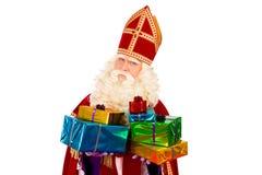 Sinterklaas montrant des cadeaux image libre de droits