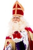Sinterklaas montrant le cadeau Images libres de droits