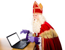 Sinterklaas with notebook Royalty Free Stock Image