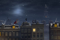 Sinterklaas and the Pieten on the rooftops at night Stock Photography