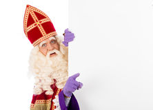 Sinterklaas with placard. Isolated on white background. Dutch character of Santa Claus Stock Photo