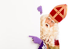 Sinterklaas pointing on placard. Sinterklaas with placard. isolated on white background. Dutch character of Santa Claus Royalty Free Stock Images