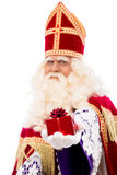 Sinterklaas showing gift Royalty Free Stock Images