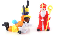 Sinterklaas and some pieten. Sinterklaas and black pieten, characters from a traditional dutch holiday; isolated on white Stock Photo