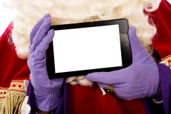 Sinterklaas with tablet Royalty Free Stock Image