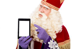 Sinterklaas with tablet Royalty Free Stock Photography