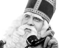 Sinterklaas with telephone.Monochrome Royalty Free Stock Image