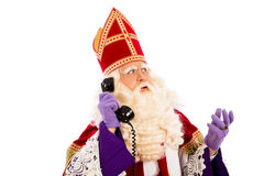 Sinterklaas with telephone. Sinterklaas with old vintage telephone. isolated on white background. Dutch character of Santa Claus Royalty Free Stock Photos