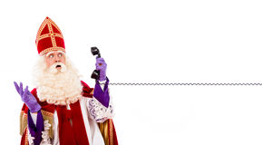 Sinterklaas with telephone Royalty Free Stock Image