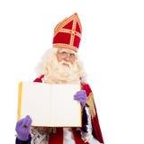 Sinterklaas z książką na białym tle Zdjęcia Stock
