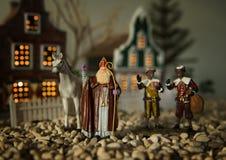 Sinterklaas, Zwarte Piet and horse. Scene of a little ceramic waving Sinterklaas (Saint Nicolas or Santaclaus), zwarte piet (black peter) and his white horse Royalty Free Stock Photo