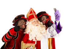 Sinterklaas and Zwarte Piet taking Selfie Stock Photography