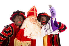 Sinterklaas and Zwarte Piet taking Selfie Stock Photos