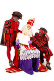Sinterklaas and Zwarte Pieten. Sinterklaas with book. isolated on white background. Dutch character of Santa Claus Royalty Free Stock Images