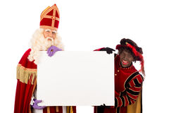 Sinterklaas and zwarte pieten with whiteboard. Sinterklaas and black pete  with placard. isolated on white background. Dutch character of Santa Claus Stock Photography