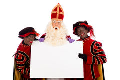 Sinterklaas and zwarte pieten with whiteboard. Sinterklaas and black pete  with placard. isolated on white background. Dutch character of Santa Claus Royalty Free Stock Image