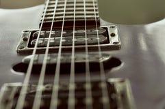 Sintonizador negro eléctrico Details de la guitarra imágenes de archivo libres de regalías