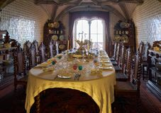 The dining room with the table served for the guests arrival. Pe royalty free stock photography