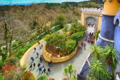Sintra, Portugal landmark, Pena Palace. Sintra, Portugal - March 28, 2018: Famous portuguese landmark, Pena Palace or Palacio da Pena and people entering Royalty Free Stock Photo