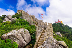 Sintra, Portugal Moorish Castle. Sintra, Portugal at Castle of the Moors wall with Pena National Palace in the distance Royalty Free Stock Image