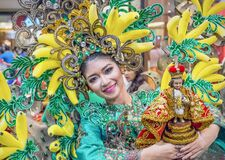 Sinulog dancer proudly holding the Santo Niño statue
