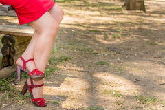 Sinuous crossed legs of over 40 woman Stock Images