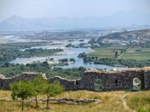 Sinuous river of Buna seen by the tall one from the citadelle of the antique city of Shkoder in Albania. Blue sky. Travel destination. Sunny day. Summertime royalty free stock image