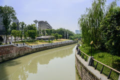 Sinuous river in city of sunny summer Stock Photo