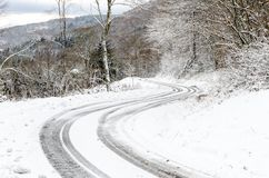 Sinuous road in winter Royalty Free Stock Photography