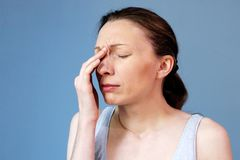 Headache woman work Sinus illness Flu Cold. Sinusitis or migraine ? Painful sinus headaches are headaches that may feel like an infection in the sinuses. Stress royalty free stock image