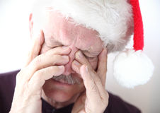 Sinus pain in man with Santa hat Royalty Free Stock Photography