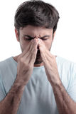 Sinus pain, sinus pressure, sinusitis. Sad man holding his nose Royalty Free Stock Photography