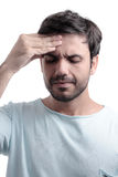 Sinus pain, sinus pressure, sinusitis. Sad man holding his nose Stock Photo