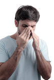 Sinus pain, sinus pressure, sinusitis. Sad man holding his nose Stock Images